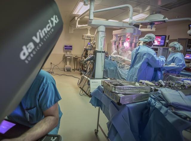 Surgeons perform robotic surgery