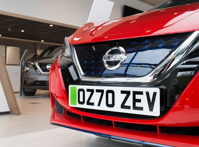 Nissan dealers are fitting green number plates to electric vehicles to give motorists a preview of what they could look like when they are launched (Nissan/PA)