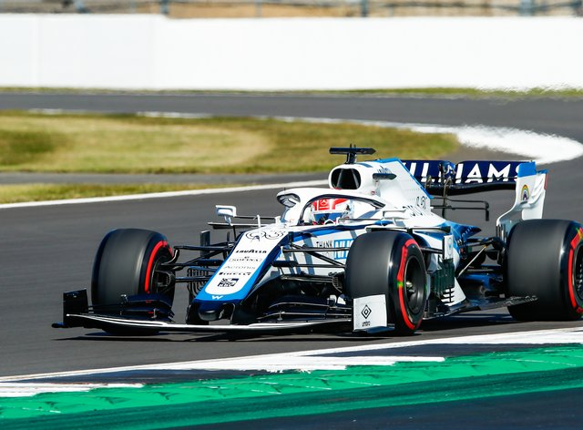 George Russell escaped injury after his Williams was struck by a flying tyre from Antonio Giovinazzi's Alfa Romeo, causing himi to crash into a wall during the Belgian Grand Prix.