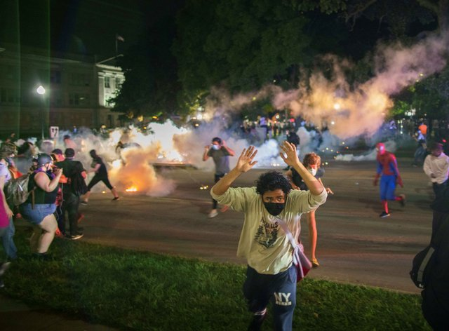 Tear gas was used by police to disperse protesters in Kenosha