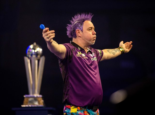 Peter Wright won 8-1 against Michael Van Gerwen on Wednesday (Steven Paston/PA).
