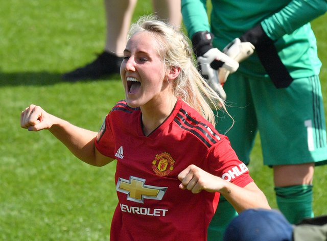 Turner earned her first England call-up on the same day as she signed her new deal with Manchester United