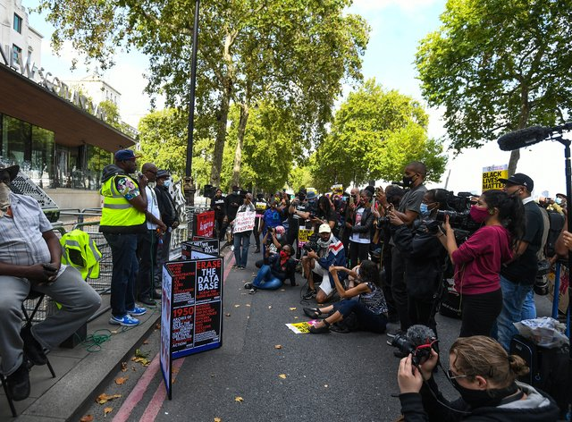Protesters outside New Scotland Yard in London as part of an anti-racism demonstration calling for Commissioner Dame Cressida Dick to resign