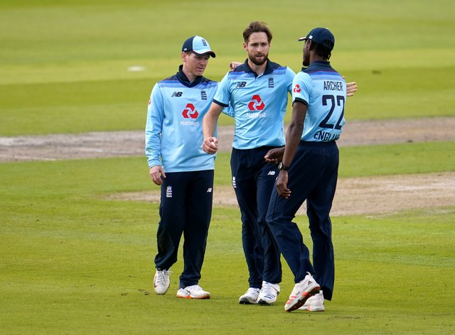 Chris Woakes (centre) says centrally-contracted players will feel impact after job cuts were announced