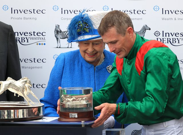 Pat Smullen is presented with his trophy for winning the Derby by the Queen
