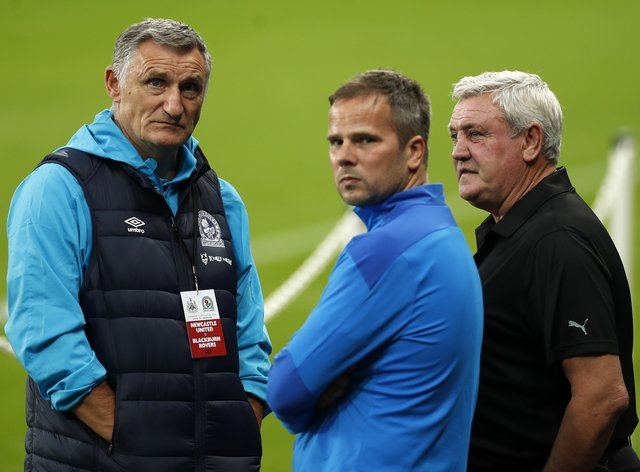 Blackburn manager Tony Mowbray and Newcastle head coach Steve Bruce (right) endured differing fortunes on Tuesday evening