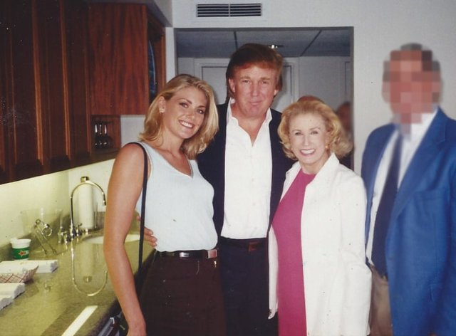 Amy Dorris, left, pictured at the US Open with Donald Trump in 1997