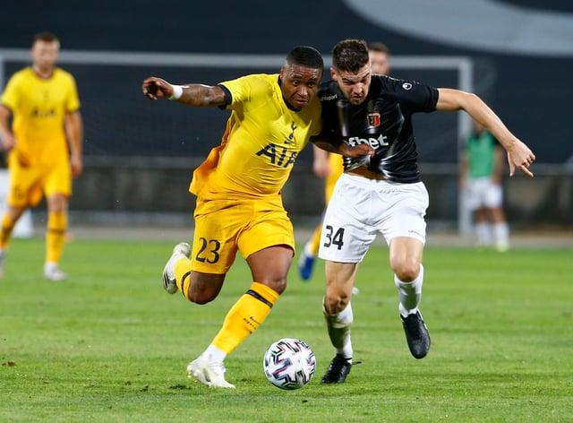Tottenham's Steven Bergwijn, left, challenges Lokomotiv's Petar Vitanov