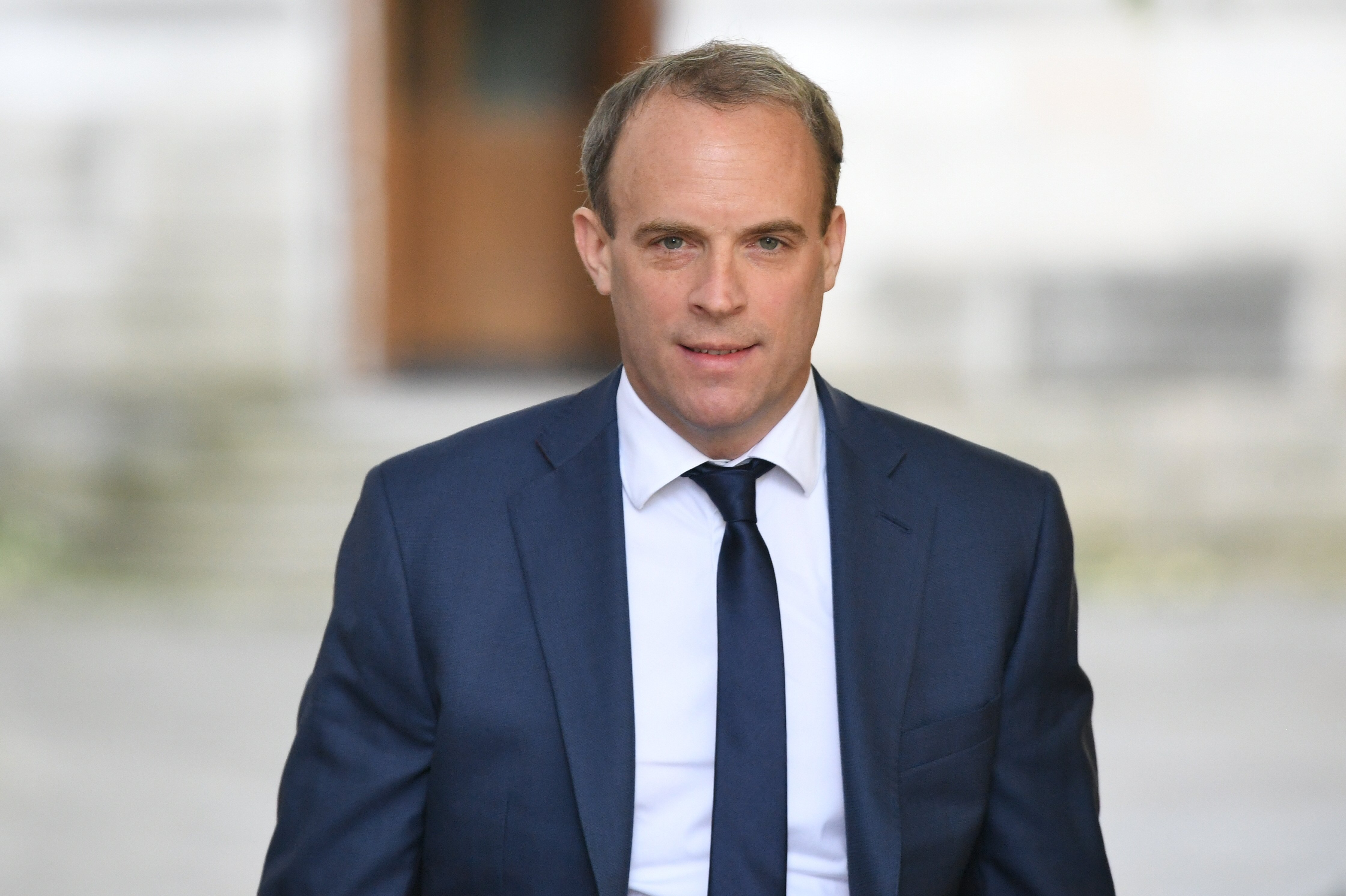 Protection officer travelling with Raab stood down after leaving gun on plane