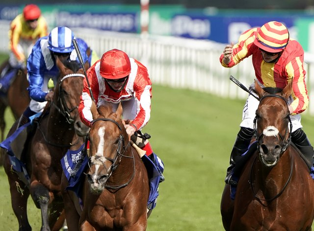 Berkshire Rocco (centre) was narrowly denied by Galileo Chrome in the St Leger