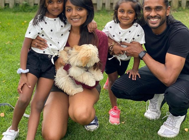 Sam Suriakumar with his wife and daughters