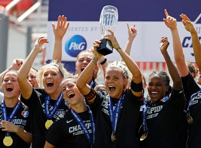 Dash players celebrate their Challenge Cup victory in July