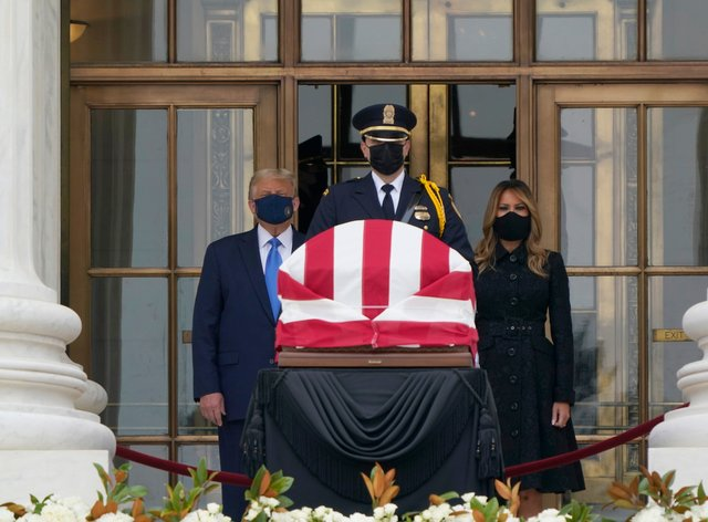 President Donald Trump and first lady Melania Trump pay respects