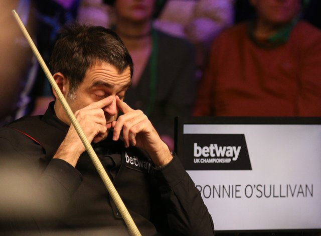 Ronnie O'Sullivan was knocked out in the second round of the European Masters by teenager Aaron Hill