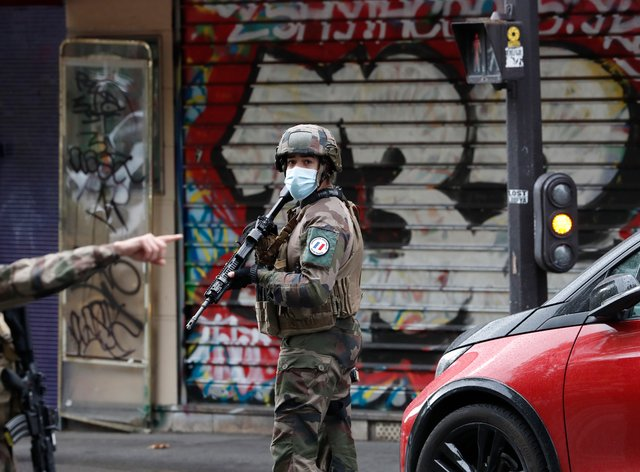 French soldiers on patrol after four people were wounded in a knife attack near the former offices of satirical newspaper Charlie Hebdo in Paris