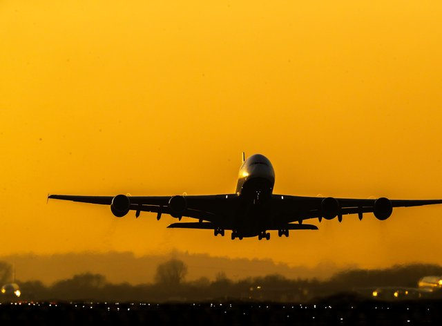 The silhouette of a plane