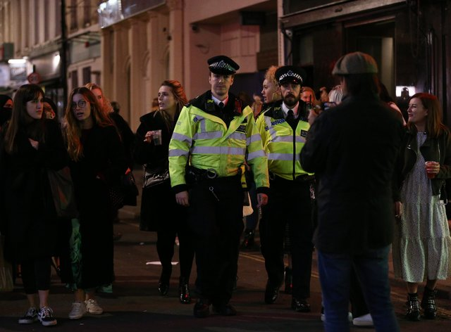 Police officers on patrol at closing time in Soho