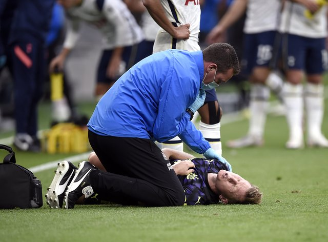 Newcastle's Matt Ritchie receives treatment on the pitch at Tottenham