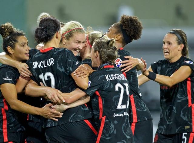 Captain fantastic Christine Sinclair scored a hat-trick as Portland Thorns beat Reign 4-1