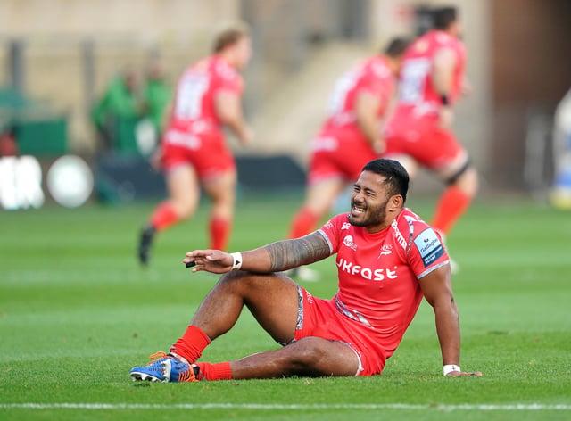 Manu Tuilagi awaits treatment in Sale's game against Northampton