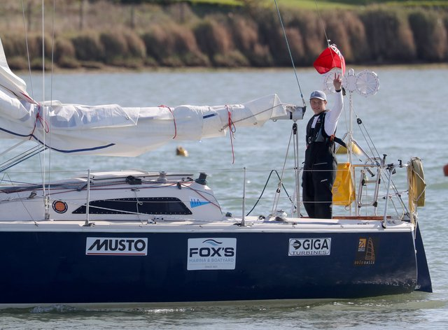 Timothy Long waves as he sails his 28ft boat into Hampshire