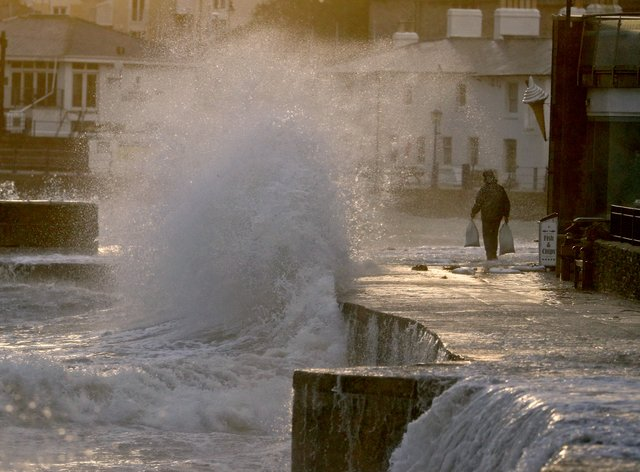 Waves crash along the coast at Swanage in Dorset
