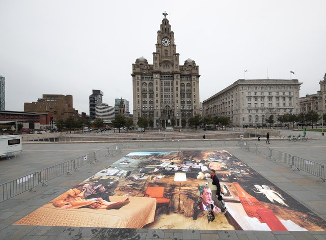 Artist Cold War Steve with his new piece of art, Trumpscape, outside the Liver Building in Liverpool (Danny Lawson/PA)