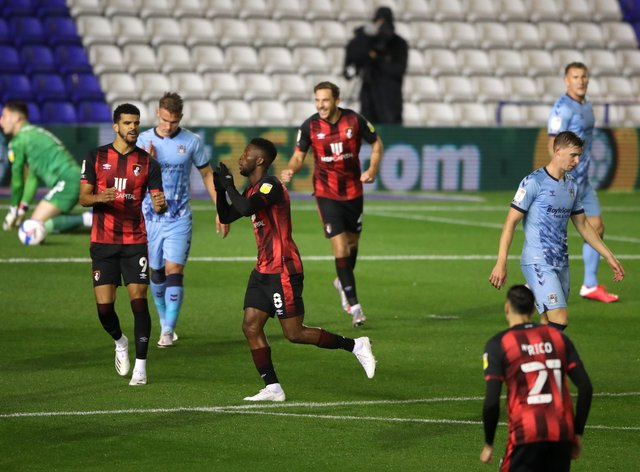 Jefferson Lerma (centre) celebrates scoring his side's first goal of the game