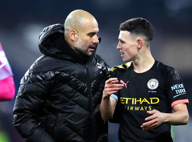 Pep Guardiola, left, and Phil Foden