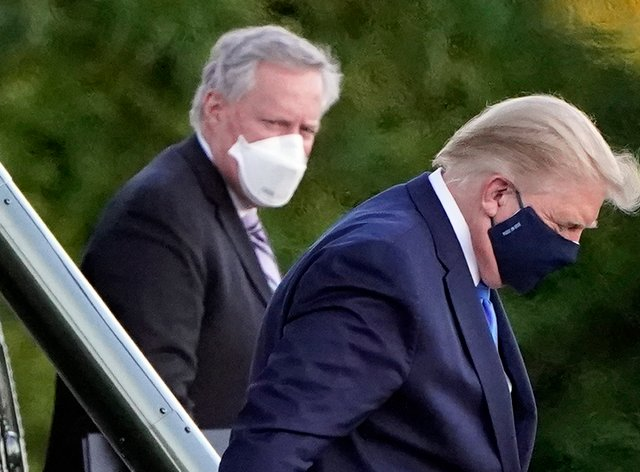 President Donald Trump, wearing a facemask, arrives at Walter Reed National Military Medical Centre on Friday