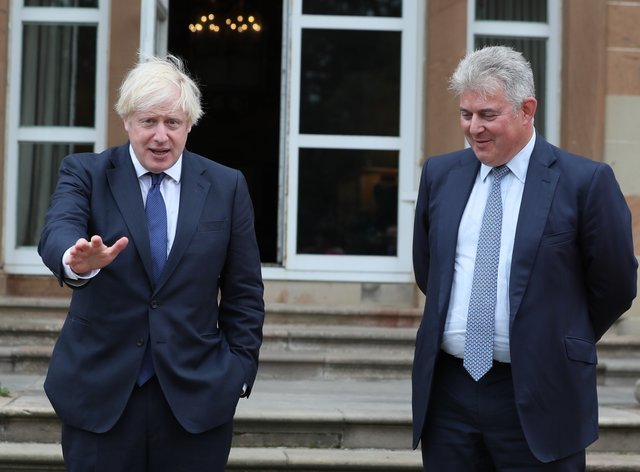 Prime Minister Boris Johnson, pictured with Northern Ireland Secretary Brandon Lewis at Hillsborough Castle in August, has set up a study to look at the feasibility of building a bridge across the Irish Sea