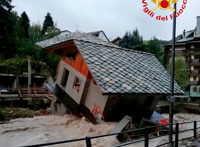 A building topples over by the Cervo river after heavy rains in Biella, northern Italy