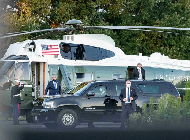 President Donald Trump arrives at Walter Reed Medical Center on Marine One for treatment after testing positive for Covid-19