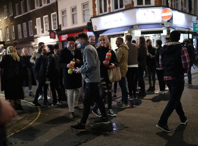 People in Soho, London, after pubs and restaurants were subject to a 10pm curfew