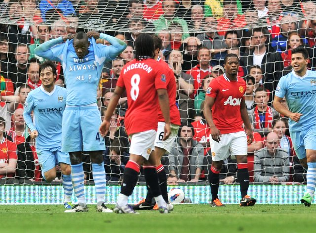 Mario Balotelli (second left) helped Manchester City to a 6-1 win at Old Trafford