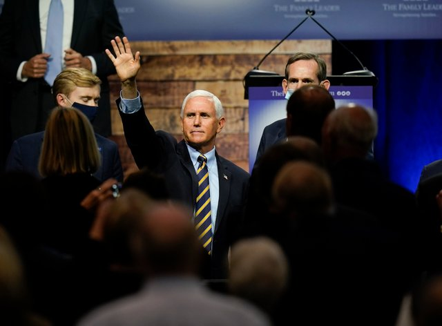 Vice President Mike Pence waves to supporters after speaking in Des Moines, Iowa (Charlie Neibergall/AP)