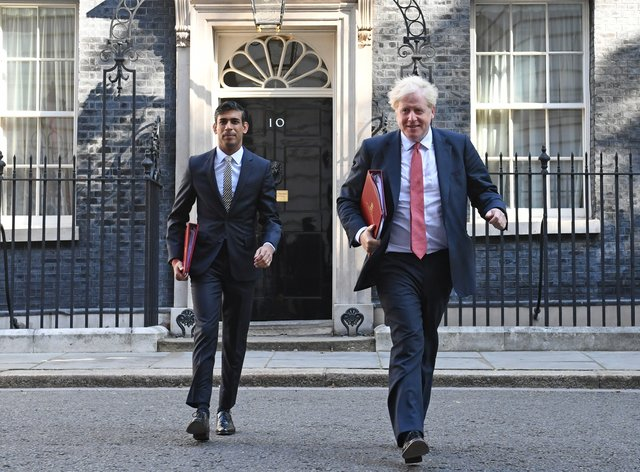 Chancellor of the Exchequer Rishi Sunak (left) and Prime Minister Boris Johnson leave 10 Downing Street, for a Cabinet meeting (Stefan Rousseau/PA)