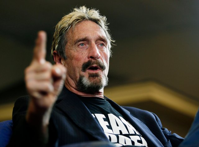 McAfee has been charged with evading taxes after failing to report income