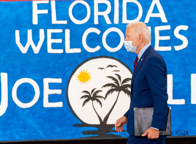 Democratic presidential candidate former vice president Joe Biden leaves after speaking at Jose Marti Gym in Miami. (Andrew Harnik/AP)
