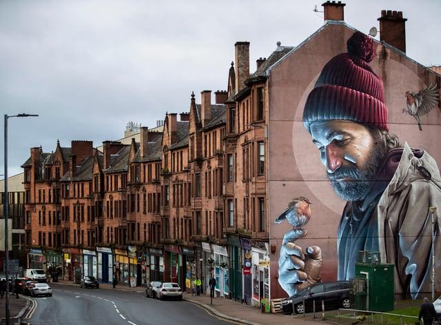 Mural of man holding bird