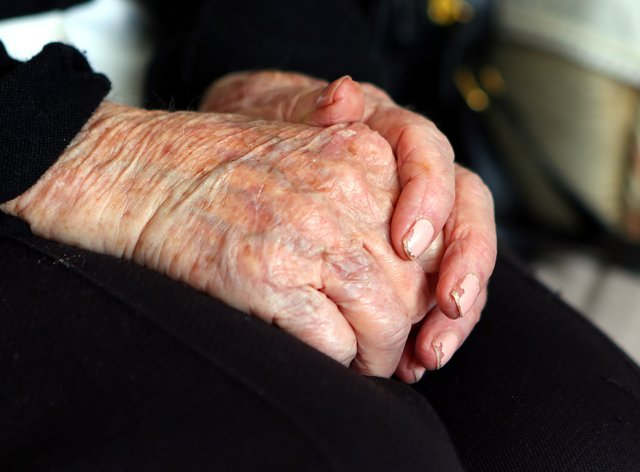 A general view of a close up of the hands of an elderly woman at home. (Peter Byrne/PA)