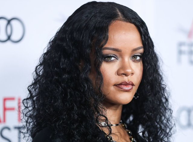 Rihanna has apologised after using a controversial song