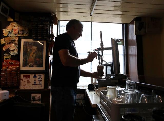 Barman in a pub