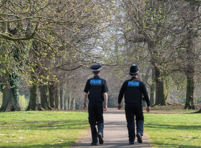 Police officers patrol in a park