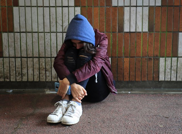Picture posed by a model of a teenage girl showing signs of mental health issues