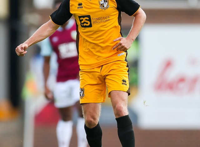 James Gibbons came off injured in Port Vale's EFL Trophy match against Wigan (Barrington Coombs/PA).
