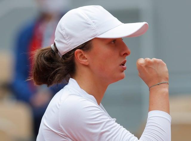 Iga Swiatek clenches her fist during her semi-final victory over Nadia Podoroska