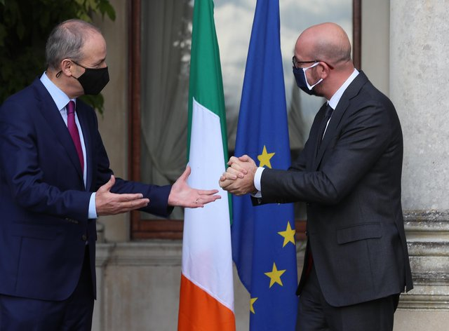 Taoiseach Micheal Martin (left) welcomes the President of the European Council, Charles Michel, as he arrives for a press conference at Farmleigh House, Dublin (Brian Lawless/PA)