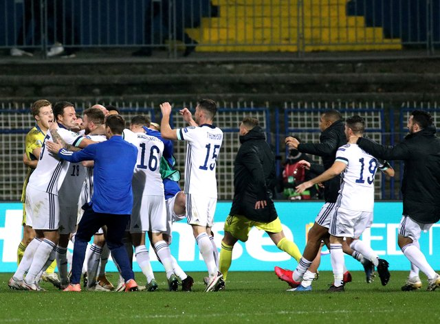 Northern Ireland players celebrate after their penalty shoot-out win in Sarajevo