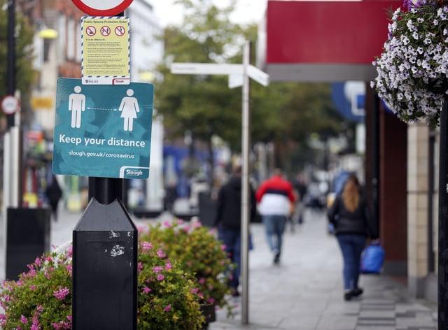 Coronavirus restrictions sign on shopping street